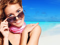 Close up of a young woman smiling over beach backgroound Stock Photography