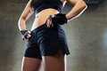 Close up of young woman torso and hips in gym sport fitness bodybuilding people concept Stock Images