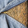 Close up of zipper with grunge wall in blue denim. Stock Photos