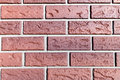 Close view of a fake plastic brick wall very vinyl siding formed in the shape bricks Royalty Free Stock Photos