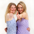 Close view of pretty women giving thumbs up Stock Photos