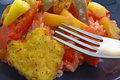 Close view sweet sour chicken with fork Stock Image