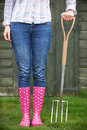 Close Of Woman Wearing Pink Wellingtons Holding Garden Fork Royalty Free Stock Photo