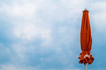 Closed beach umbrella against the sky Royalty Free Stock Photo