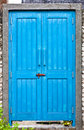 Closed blue wooden door feature Stock Images