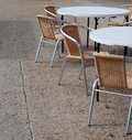 Closed cafe tables and chairs Stock Images