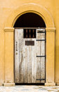 Closed door wooden covered with wrought iron of old building Stock Photo