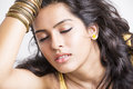 Closed eyes indian young pretty girl in dream dreaming posing to the camera Royalty Free Stock Photo