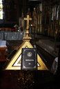 Closed holy Bible book lying on a pew in the church illuminated by ray of light Royalty Free Stock Photo
