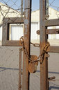 Closed industrial factory rusty padlock and chain securing gates of down warehouse site Stock Images