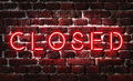 Closed neon sign red on brick wall Royalty Free Stock Image