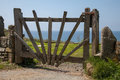 Closed old wooden gate above druidstone beach Stock Photo