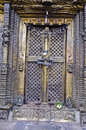 Closed ornate decorative brass door with locks temple nepal Royalty Free Stock Images