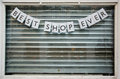 Closed shop window with sign saying Royalty Free Stock Photo