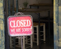 Closed sign outside a shop window. Royalty Free Stock Photo