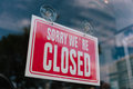 Closed sign in shop window Royalty Free Stock Photo