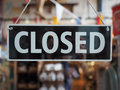 Closed sign on a shop window Royalty Free Stock Photo