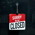 Closed sign in a shop window sorry we are closed Royalty Free Stock Photo