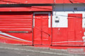 Closed store colorful red door and shutter on a Stock Photos