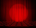 Closed theater red curtains with spotlight and seats Royalty Free Stock Photo