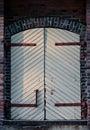 Closed and unlocked door at wall Royalty Free Stock Photo