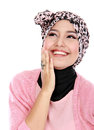 Closed up of a laughing beautiful muslim woman over white background Royalty Free Stock Images
