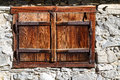 Closed vintage window on stone wall a house. Outdoors alpine scene, Austria, Tirol Royalty Free Stock Photo
