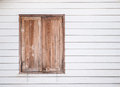 Closed vintage wooden window on white wall isolated Stock Photo