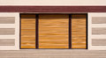 Closed window with brown wooden shutters background Royalty Free Stock Photo