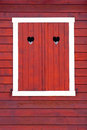 Closed window shutters red color stained wood her heart symbol Royalty Free Stock Photo