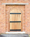 Closed wooden door with brick wall building Stock Photography