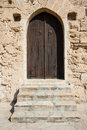Closed wooden door of medieval fortress Stock Image