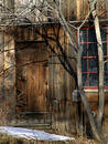 Closed wooden door in old building Stock Photography