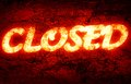 Closed written on a glowing red background Stock Photography
