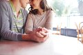 Closeness close up of romantic couple sitting in cafe on summer day Stock Photos