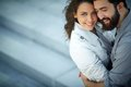 Closeness image of happy women looking at camera while being embraced by her sweetheart Royalty Free Stock Photography