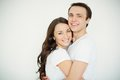 Closeness portrait of amorous young women and men embracing and looking at camera Stock Image