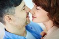 Closeness portrait of tender couple looking at one another Royalty Free Stock Photo