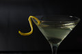 Closer martini view of a vodka or gin with a lemon twist Stock Photography