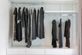 Closet with row of black dress hanging on coat hanger Royalty Free Stock Photo