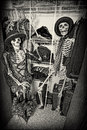 Closet skeletons two enjoying themselves in someone s grain intended Stock Images