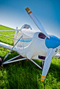 Closeup airplane on the field Royalty Free Stock Photo