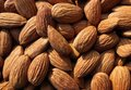 Closeup of Almond nuts heap abstract food product background Royalty Free Stock Photo
