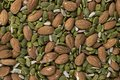 Closeup of almond, sunflower, and pumpkin seeds Royalty Free Stock Photo