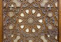 Closeup of arabesque ornaments of an old aged decorated wooden door, Cairo, Egypt