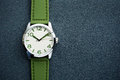 Closeup automatic men watch with green wrist on dark background Royalty Free Stock Photo