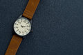 Closeup automatic men watch with leather wrist on dark background Royalty Free Stock Photo