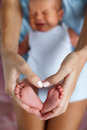 Closeup of baby feet and mother hands Royalty Free Stock Photo