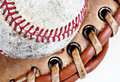 Closeup of baseball in glove Stock Image