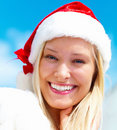Closeup of a beautiful girl wearing Santa's hat Stock Photo